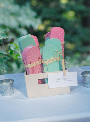 backyard wedding flip flop basket for guests who did not bring garden appropriate shoes
