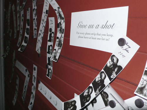wedding photobooth strips hung to metal door with magnets