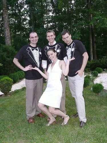 fun backyard wedding photo with groom and his friends wearing tuxedo tshirts