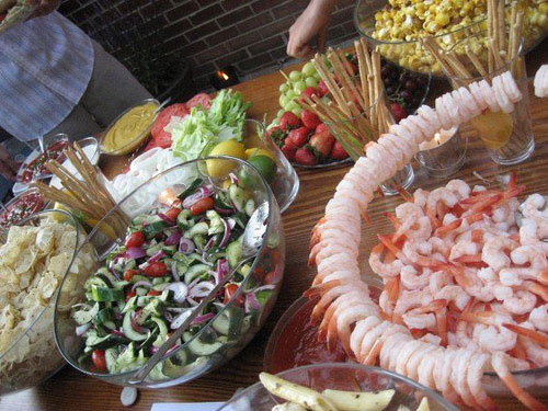 Food Spread At Affordable Diy Backyard Wedding Including Bowl Of Fruit Salad And Tail Shrimp